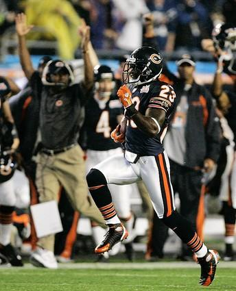 An excited Lovie Smith holds his hands in the air as Devin Hester returns the opening kick-off for a 92-yard touchdown during Super Bowl XLI.