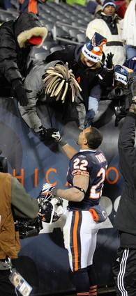 Matt Forte shakes some hands after a big win against New Orleans.