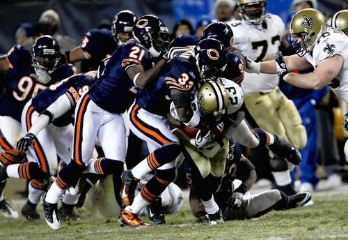 Charles Tillman leads the defense to stop New Orleans RB Pierre Thomas a 4th and 1 late in the game.