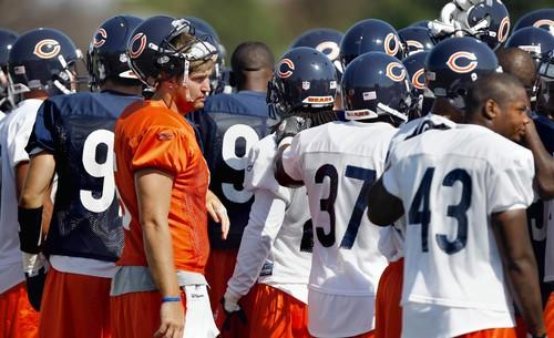 Quarterback Jay Cutler huddles up with his teammates in the practice before Saturday's exhibition game vs. the Bills.