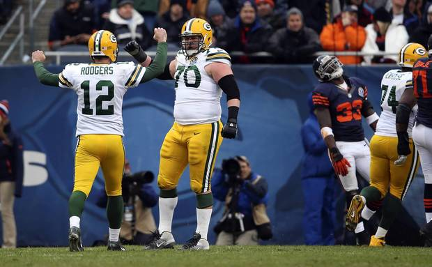 Charles Tillman reacts as the Packers' TJ Lang celebrates a touchdown with Aaron Rodgers in the 2nd quarter.