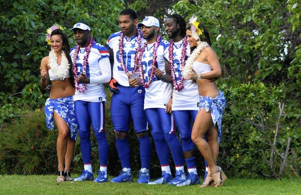 Corey Graham, Julius Peppers, Matt Forte and Charles Tillman pose with their Hawaiian hostesses after their team photo at NFC media day for the 2012 Pro Bowl at the JW Marriott Ihilani Resort.