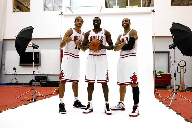 Joakim Noah, Luol Deng and Carlos Boozer pose for a photograph.