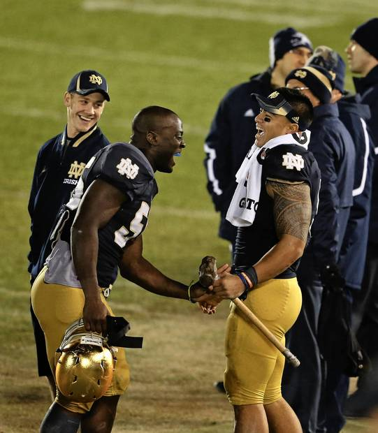 Prince Shembo celebrates with Manti Te'o after their team's 38-0 win.
