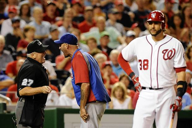 Cubs manager Dale Sveum argues with home plate umpire Larry Vanover after being thrown out in the fifth inning.