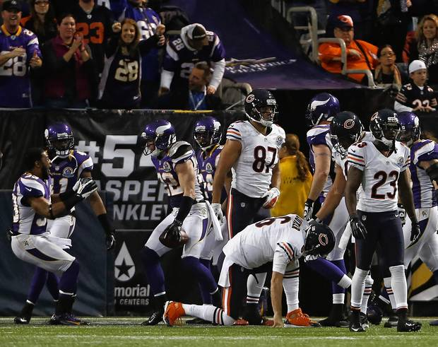 Jay Cutler gets up as the Vikings' Harrison Smith celebrates his interception return for a touchdown in the third quarter.