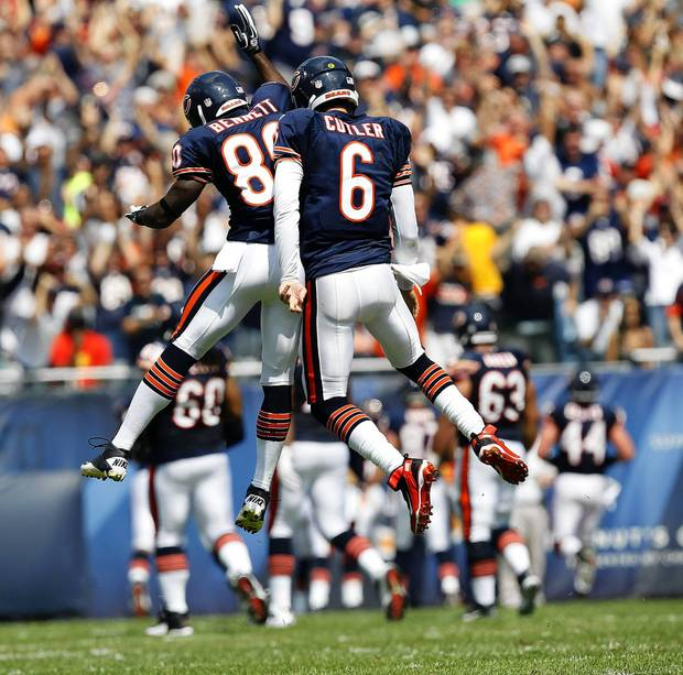 Jay Cutler and Earl Bennett celebrate a touchdown by Matt Forte in the first quarter against the Falcons at Soldier Field.