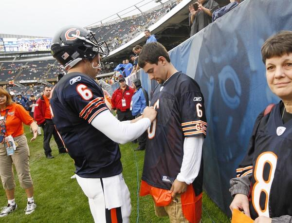 Jay Cutler signs a jersey for a fan before an exhibition game against the Bills at Soldier Field.
