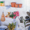 Hang a pegboard wall
