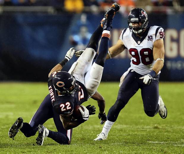 Texans cornerback Johnathan Joseph tackles Matt Forte in the second quarter.