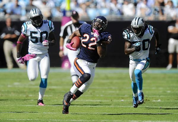 Matt Forte breaks away from Carolina's James Anderson and Charles Godfrey for a 68-yard touchdown in the 1st quarter.
