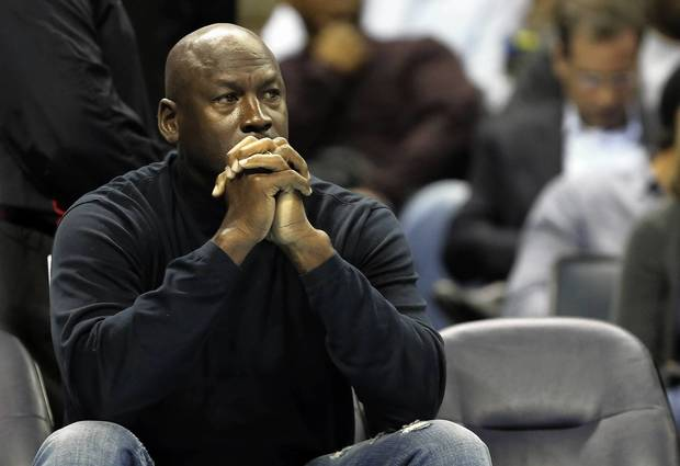 Bobcats owner Michael Jordan watches a game against the Pacers.