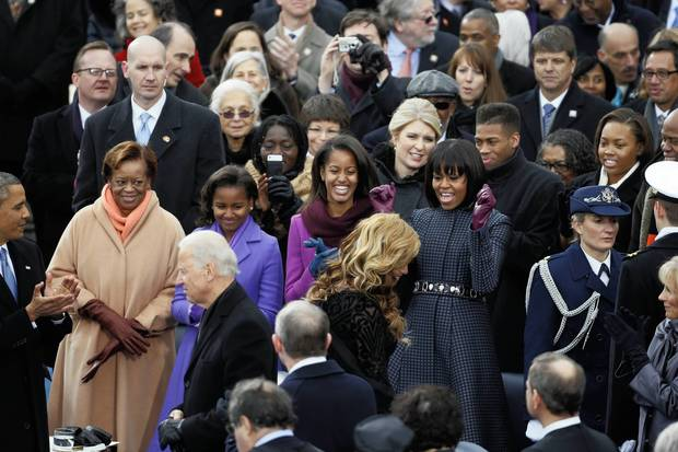 Beyonce is cheered by first lady Michelle Obama as she leaves the stage after singing the National Anthem at President Barack Obama's inauguration ceremony at the U.S Capitol