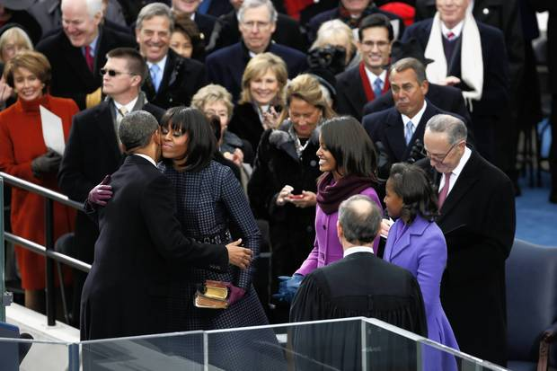 President Barack Obama hugs first lady Michelle Obama after taking the oath of office during ceremonies at the U.S Capitol in Washington.