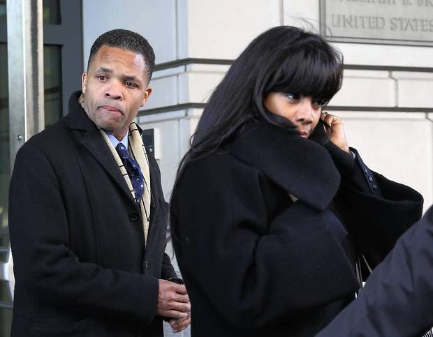 Former U.S. Rep. Jesse Jackson Jr. (D-Ill.) and former Chicago Alderman Sandi Jackson leave U.S. District Court in Washington, D.C., where they plead guilty to federal charges regarding misuse of campaign funds and falsifying a tax return.