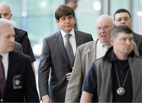 Former Illinois Governor Rod Blagojevich walks out of the Dirksen U.S. Courthouse in Chicago following a status hearing. His trial begins on June 3, 2010.