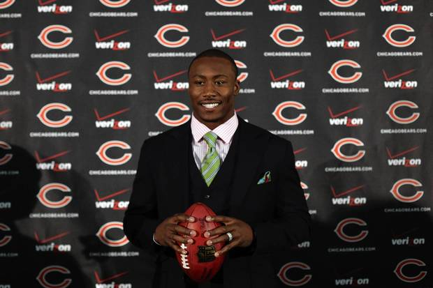 Brandon Marshall poses for the media after a press conference at Halas Hall.