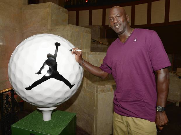 Michael Jordan signing his Ryder Cup Magnificent Moments golf ball at Michael Jordan's Steakhouse on August 20, 2012.
