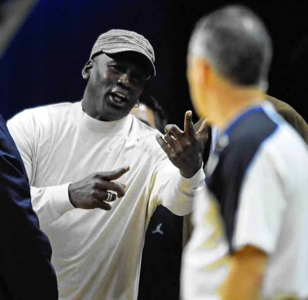 Bobcats owner Michael Jordan makes a point to an official during the closing moments of the game between the Bobcats and Bucks.