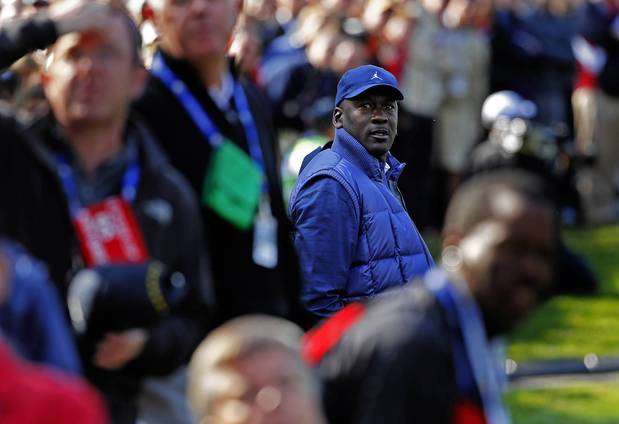Michael Jordan watches the first group of the European and USA Ryder Cup teams tee off on the thirteenth fairway on the first day of competition at Medinah Country Club.