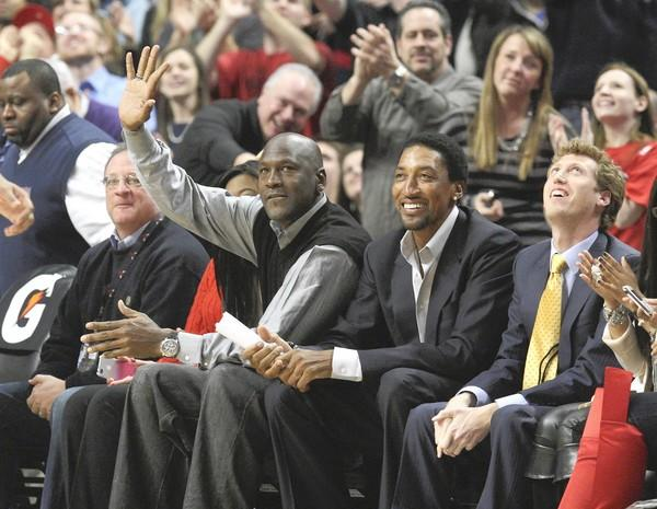 Michael Jordan waves during standing ovation for himself and Scottie Pippen during the first quarter of the Bulls-Bobcats at the United Center.