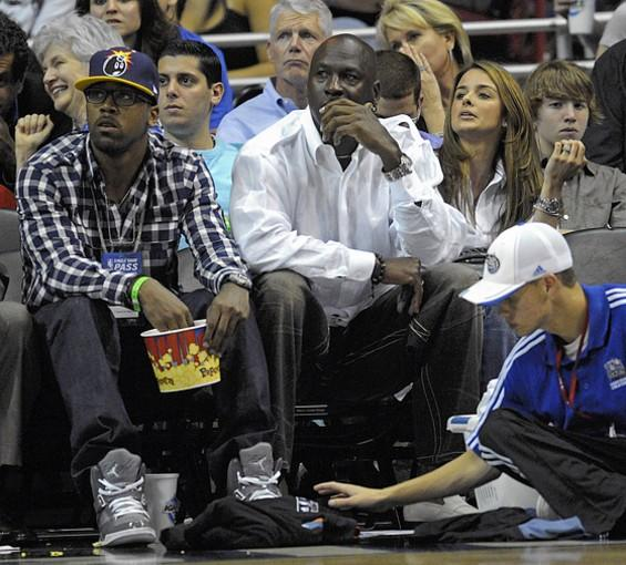 Central Florida's Marcus Jordan sits next to his father during an NBA playoff game in Orlando.