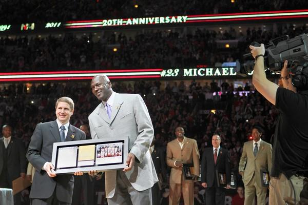 Michael Jordan poses for pictures as other members of the 1991 championship team stand behind him as the organization commemorates the 20th anniversary of the Bulls first NBA championship.