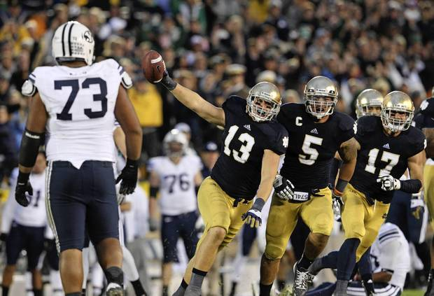 Danny Spond celebrates his interception with a handful of seconds left on the clock while BYU's Solomone Kafu walks away at Notre Dame Stadium.