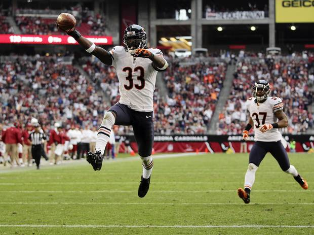 Charles Tillman celebrates his interception return for a touchdown against the Cardinals in the 3rd quarter.