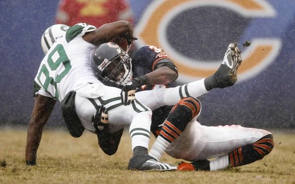 Charles Tillman tackles Jets' Jerricho Crotchery in the 1st quarter.