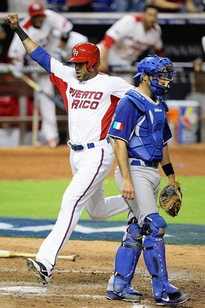 Puerto Rico's Alex Rios scores on a single by Andy Gonzalez in the eighth inning against Italy in the World Baseball Classic elimination game at Marlins Park.