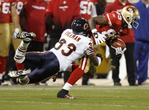 Charles Tillman goes after the 49ers' Jason Hill during the first quarter.