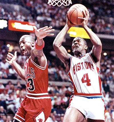 Michael Jordan's next hurdle was Joe Dumars and the Pistons, losing to them in the 1989 and 1990 Eastern Conference Finals. Here, Dumars drives past Jordan in the seventh and deciding game of the 1990 series.