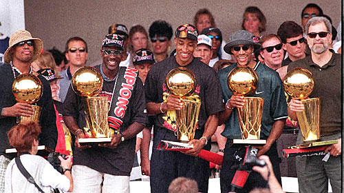 In case Jordan's handful of fingers didn't communicate the number of titles the Bulls had after beating the Jazz in 1997, the image of (from left) Dennis Rodman, Jordan, Scottie Pippen, Ron Harper and Phil Jackson holding a trophy each at a rally in Grant Park does the trick.