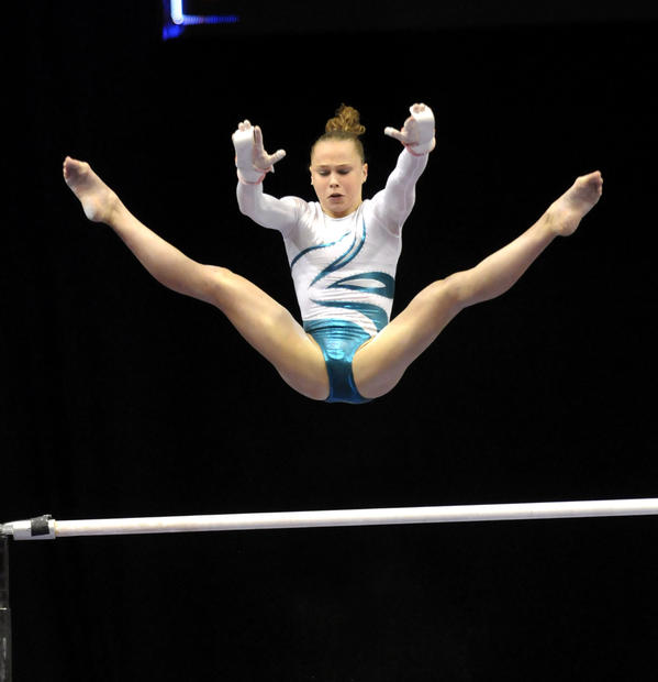 Rebecca Bross performs on the uneven bars during the first rotation. The women's senior gymnastics competitors performed Thursday night during the 2010 VISA Championships being held at the XL Center.