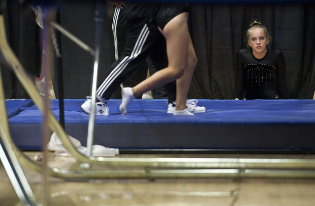 Mackenzie Kulka watches as other competitors warm up for the Junior Tramp competition during the 2010 Visa Gymnastics Championship at U of Hartford on August 10, 2010.