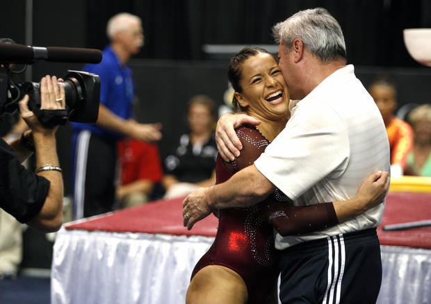 Alicia Sacramone hugs her coach Mihai Brestyan after competing on the Bar during the Women's finals competition of the Visa Gymnastics Championships at the XL Arena in Hartford, Conn. on August 14, 2010.