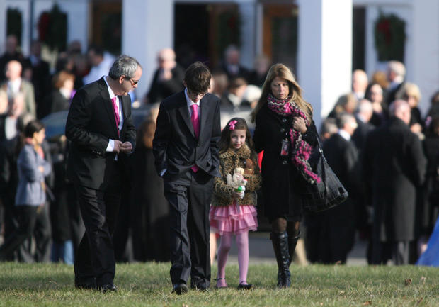 At St. Rose of Lima Church in Newtown a family leaves a funeral mass for Caroline Previdi, 6. The family wore pink, in honor of the Sandy Hook Elementary school student who died in the school shooting Friday.