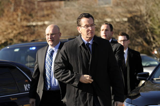 Gov. Dannel Malloy arrives at the scene of a shooting at Sandy Hook Elementary School in Newtown.