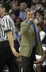 Jim Calhoun has some words for referee Joe Lindsay after he was called for a technical foul early in the game.