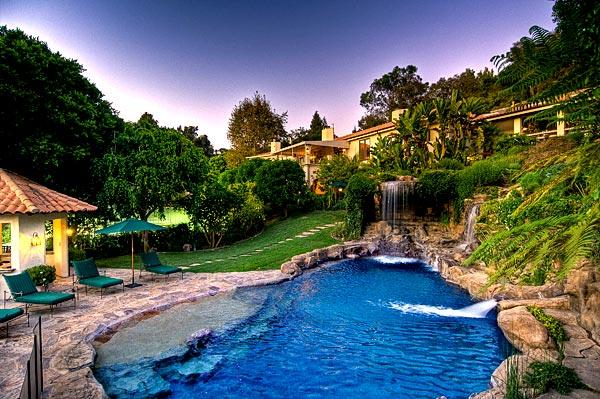 Among outdoor amenities is a grotto-style pool with waterfalls.