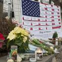 A flag bearing the names of the victims