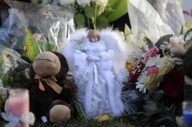 A beautiful angel was brought by a mourner and placed at a makeshift memorial near Sandy Hook School on Saturday.
