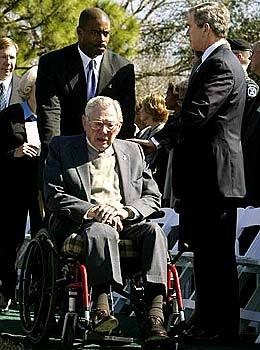 President Bush reaches out to Paul Brown, father of deceased astronaut Dave Brown, during a memorial service for the seven astronauts who died in the shuttle disaster. The president attended the service along with family members of the crew and up to 14,000 NASA employees.