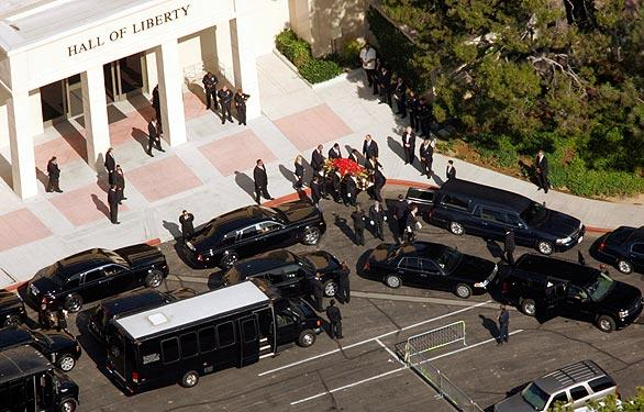 The casket containing the body of Michael Jackson is carried to the hearse at Forest Lawn cemetery.