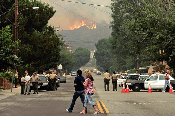 A view of Pennsylvania Avenue in La Crescenta where people gathered to watch the fire raging in the mountains on Tuesday morning.