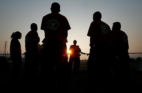 Firefighters from the Northern Cheyenne Initial Attack Crew in Montana hold a morning meeting at Hansen Dam Park.