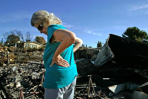 Darlene Westman surveys what is left of her mobile home at Sky Terrace Mobile Lodge, where she lived for 25 years.