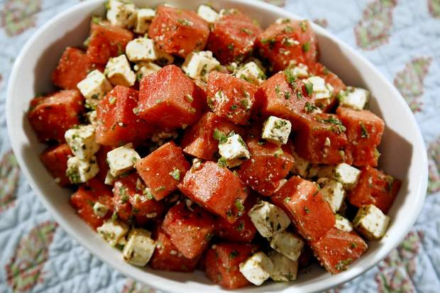 "Cubed watermelon is combined with feta, mint a little jalapeno and a cumin-lime dressing. <a href=""http://www.latimes.com/features/food/la-fo-calcook-rec1-20120804,0,4621988.story"">Recipe</a>."