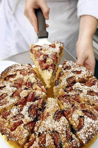 "The rolled-oat cake with figs is sliced into servings at Proof Bakery in Atwater Village. <a href=""http://www.latimes.com/features/food/la-fo-proof-bakery-rec1-20120929,0,2540948.story"">Recipe</a>"